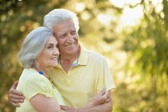 Portrait of beautiful senior couple relaxing in the spring park stock image