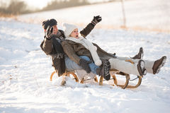 Beautiful senior couple on sledge having fun, winter day. Royalty Free Stock Photography