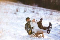 Beautiful senior couple on sledge having fun, winter day. Stock Photos