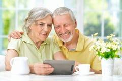 beautiful senior couple using tablet Royalty Free Stock Photography