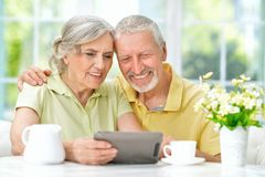 beautiful senior couple using tablet Royalty Free Stock Photography