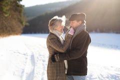 Beautiful senior couple on a walk on sunny winter day Stock Image