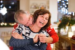 Senior couple at Christmas time. Beautiful senior couple in woolen sweaters with nordinc pattern at Christmas time Stock Image