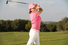 Beautiful senior female golf player Stock Photo