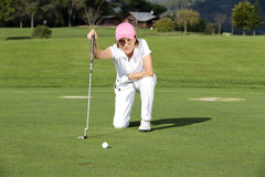 Beautiful senior female golf player Stock Image
