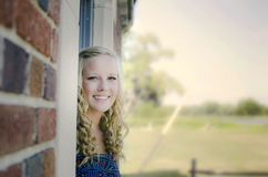 A beautiful blonde high school senior. A female senior portrait shoot smiles at the camera during a summer shoot in Iowa stock photos