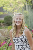 Nature portrait of a young female in iowa. A female senior portrait shoot smiles at the camera during a summer shoot in Iowa stock images