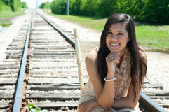 Beautiful senior girl sitting on train tracks. Royalty Free Stock Photography