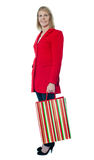 Beautiful senior lady holding shopping bag Stock Photo