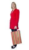 Beautiful senior lady holding shopping bag stock photo