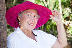Beautiful Senior Lady Tips Hat Royalty Free Stock Photography