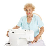 Beautiful Senior Sewing Stock Photo