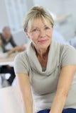 Beautiful senior woman amongst others Stock Photo