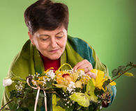 Beautiful senior woman with bouquet of flowers Stock Images