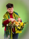 Beautiful senior woman with bouquet of flowers Royalty Free Stock Image