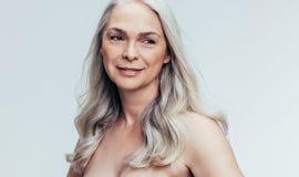 Beautiful senior woman contemplating royalty free stock image