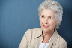 Beautiful senior woman daydreaming Stock Photography