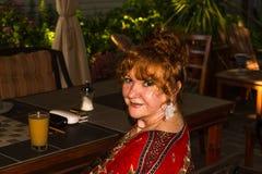 Beautiful senior woman. Senior Eastern European woman sitting with coffee royalty free stock photography