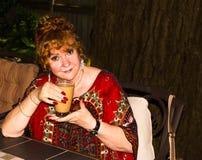 Beautiful senior woman. Senior Eastern European woman sitting and drinking coffee stock photography