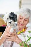 Beautiful senior  woman hugging her dog Royalty Free Stock Images