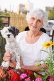 Beautiful senior  woman hugging her dog Stock Photography