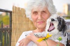 Beautiful senior  woman hugging her dog Royalty Free Stock Image