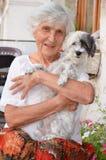 Beautiful senior  woman hugging her dog Royalty Free Stock Photos