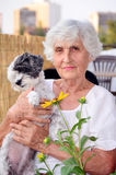 Beautiful senior  woman hugging her whitdog Stock Photo