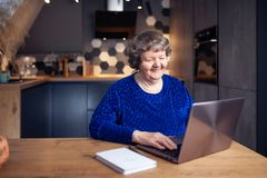 Beautiful senior woman in modern home royalty free stock photo