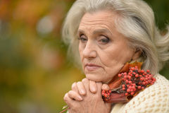 Beautiful senior woman outdoors. Portrait of a beautiful senior woman outdoors Royalty Free Stock Images