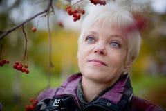 Beautiful senior woman relaxing in the fall park stock photos