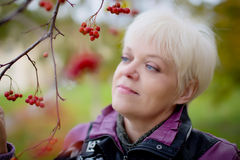 Beautiful  senior woman relaxing in the fall park Royalty Free Stock Photos