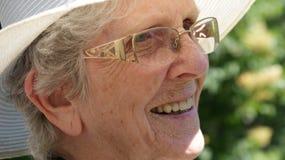 Beautiful senior woman smiles Stock Images