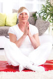 Beautiful senior woman, yoga lotus pose Royalty Free Stock Photo