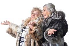 Beautiful senior women. Portrait of a beautiful senior women in fur coats Stock Images