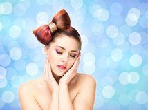 Beautiful sensitive girl with a bow haircut and colorful make-up Royalty Free Stock Photography