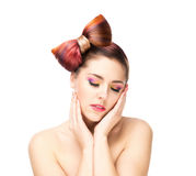 Beautiful sensitive woman with a bow hairstyle and colorful eye shadows Royalty Free Stock Images