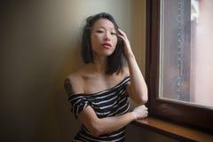 Beautiful sensual asian woman posing looking seductive at camera Royalty Free Stock Photos