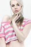 Beautiful sensual blond girl. In mini t-shirt Royalty Free Stock Image