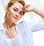 Beautiful sensual blonde girl in white blouse on hot sunny day Stock Photo