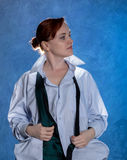 Beautiful sensual businesswoman in men`s shirt and tie on a blue background. Beautiful sensual young woman in men`s shirt and tie on a blue background Stock Photography