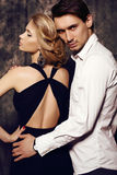 Beautiful sensual couple in elegant clothes Stock Photos