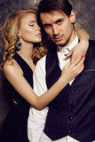 Beautiful sensual couple in elegant clothes posing in studio Royalty Free Stock Images