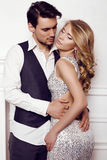 Beautiful sensual couple in elegant clothes posing in studio. Fashion studio photo of beautiful sensual couple in elegant clothes Stock Photo