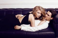 Beautiful sensual couple in elegant clothes posing in studio Royalty Free Stock Photos