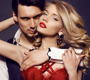 Beautiful sensual couple in elegant clothes posing in studio Stock Photo