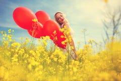 Beautiful sensual girl with balloons Stock Photos