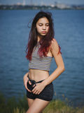 Beautiful, Sensual Girl Walking Near The River. A Stylish Teen On A Blurred Natural Background. Natural Beauty Concept. Royalty Free Stock Image