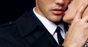 Beautiful sensual impassioned couple. office love story. Fashion studio photo of beautiful sensual impassioned couple. office love story stock images