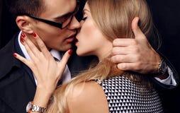 Beautiful sensual impassioned couple. office love story. Fashion studio photo of beautiful sensual impassioned couple. office love story royalty free stock images
